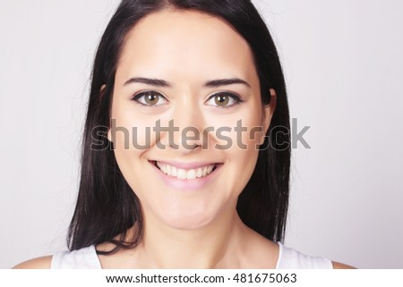 Closeup portrait of beautiful caucasian young woman, isolated over grey background.
