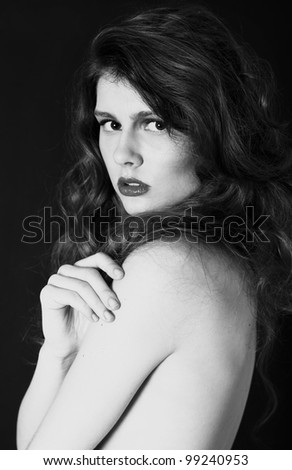Closeup portrait of beautiful woman with amazing hairstyle  in studio