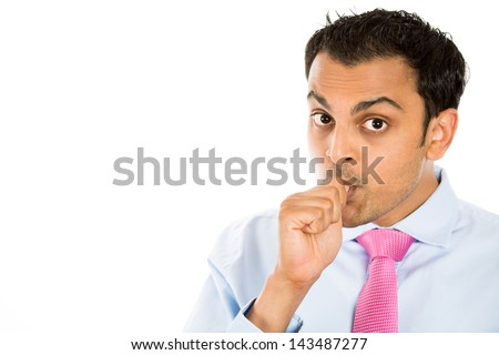 Closeup portrait of handsome man sucking his thumb, with copy space to left, isolated on white background