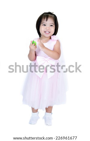 Closeup portrait of happy Asian little girl on white background