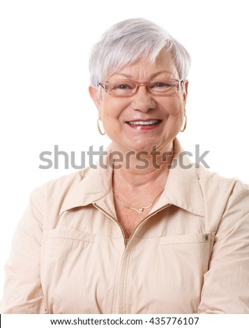 Closeup portrait of happy elderly lady, smiling, looking at camera.