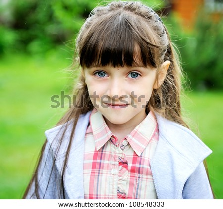 Closeup portrait of little girl in contemporary school outfit