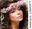 Closeup Portrait of Pretty Woman with Wreath of Pink Flowers. Natural Beauty - stock photo