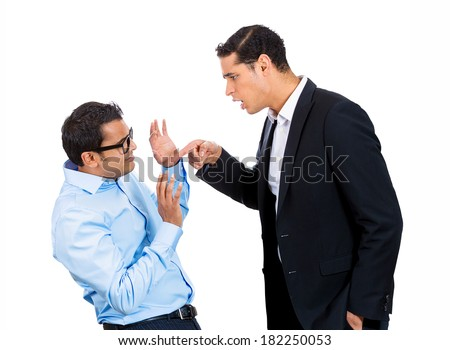 Closeup portrait of rude, mad, giant business man threatening, pointing at his nerdy guy coworker, isolated on white background. Negative emotion facial expression feelings. Office conflict resolution