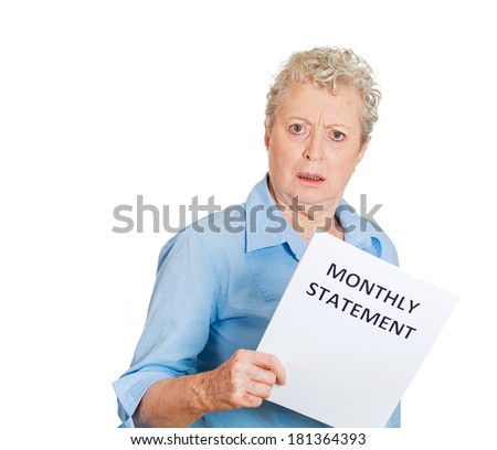 Closeup portrait of sad shocked funny looking senior old woman disgusted at her monthly statement isolated white background. Negative human emotion facial expression feeling. Financial crisis bad news