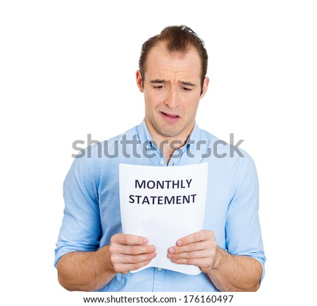 Closeup portrait of sad, shocked funny looking young man disgusted at his monthly statement, isolated on white background. Negative human emotion facial expression feelings. Financial crisis, bad news
