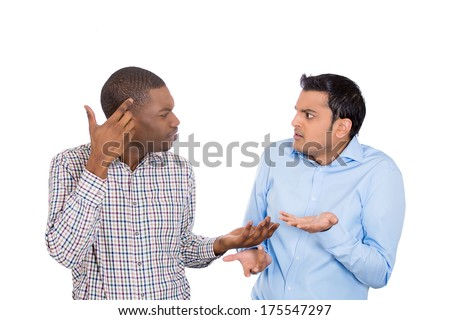 Closeup portrait of two grown mad men arguing, one asks are you crazy, other asks what did i do, isolated on white background. Negative emotion facial expression feelings, attitude, reaction. Conflict