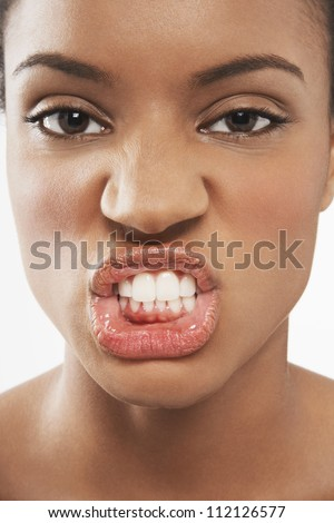 Closeup portrait of young woman snarling