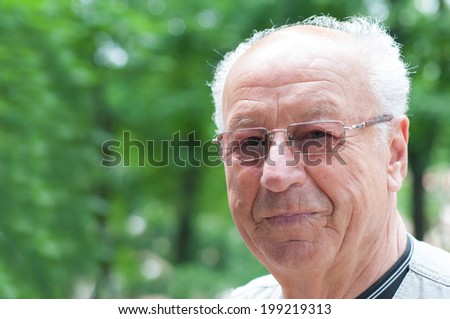 Closeup portrait on a smiling old man