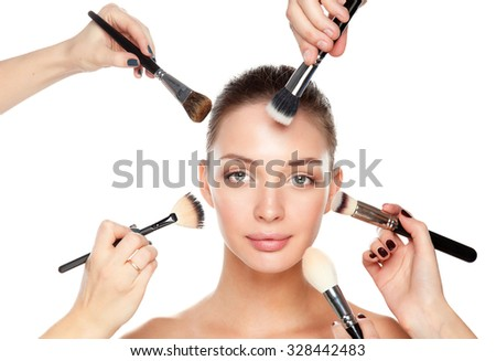 Closeup portrait picture of beautiful woman with brushes