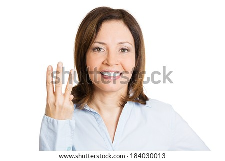 Closeup portrait, pretty young woman giving three fingers sign gesture with hands, isolated white background. Positive human emotions, facial expressions, feeling, symbols, body language