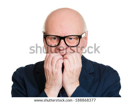 Closeup portrait, senior man, unhappy, scared nerd black glasses, biting nails, looking crazy with craving for something, anxious worried, isolated white background. Negative funny face expression