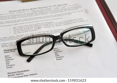 Closeup receipts with eyeglasses