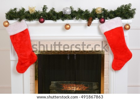 closeup santa stockings on fireplace