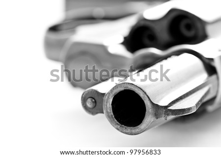 closeup shot of revolver handgun's caliber on white background