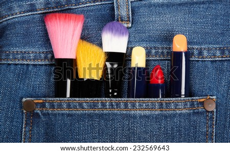 Closeup to jeans pocket with lipstick