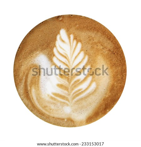 Closeup up of coffee latte foam with leaf design art isolated on a white background, viewed from top.