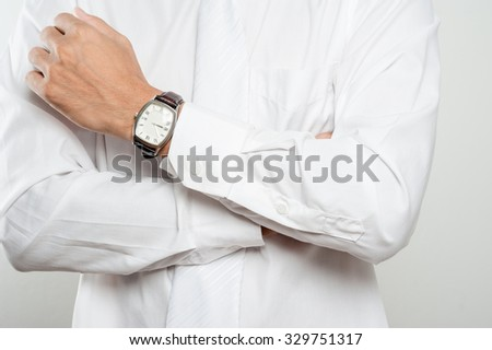closeup vintage style of luxury men watch on businessman's wrist