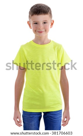 Clothes advertising. Portrait of cute boy in yellow T-shirt and jeans isolated on white background