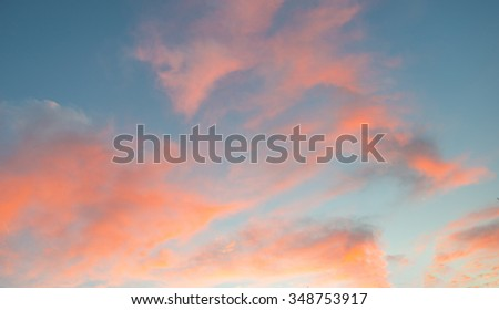 Clouds in the light of dawn in autumn