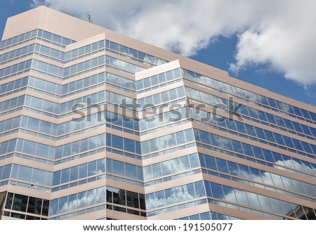 Clouds reflection in glass building