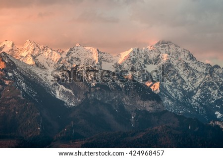 Cloudy Tatra mountains in the morning, covered with snow