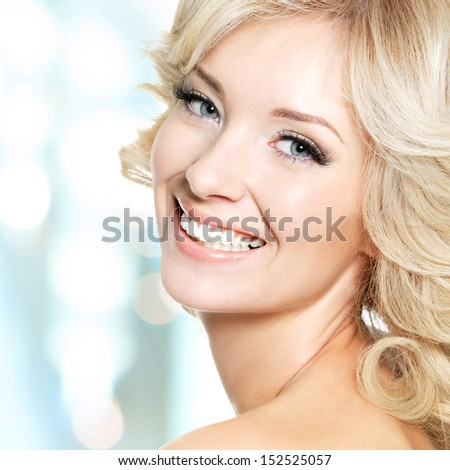 Clouseup face of beautiful woman with white hairs over art background