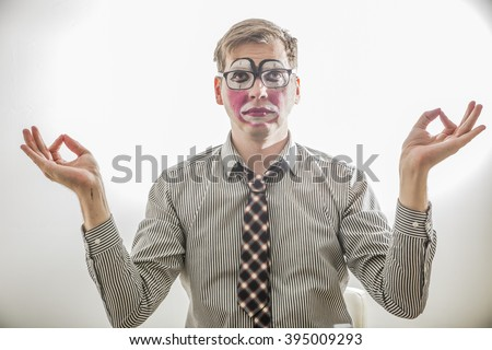 clown MIME in the pose of relaxation dressed in a tie and business shirt