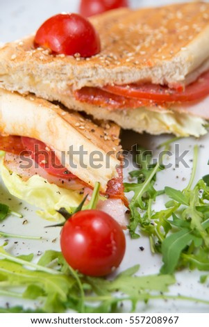 Club sandwich served on a white plate