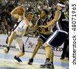 CLUJ-NAPOCA, ROMANIA- APRIL 22: Szijarto Levente in action at a Romanian National Championship basketball game U Mobitelco vs BCM Timisara April 22, 2009 in Cluj-Napoca, Romania. - stock photo