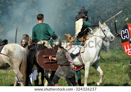 CLUJ-NAPOCA, ROMANIA - OCTOBER 3: Members of Eagles of Calata Nomadic group performing a free equestrian demonstration with Hunnic and archaic Hungarian costumes. On October 3, 2015 in Cluj, Romania