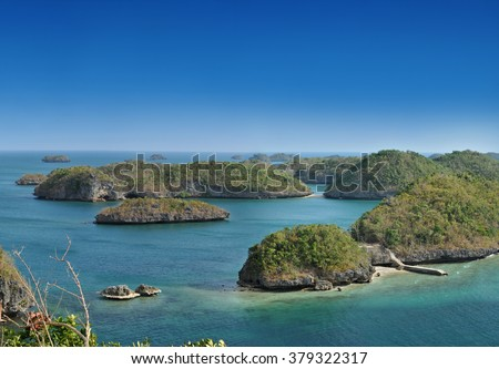 Cluster of small islands in Hundred Islands National Park, Pangasinan, Philippines.