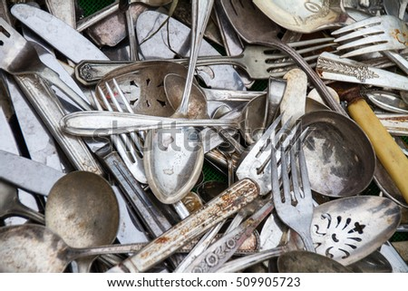 Cluttered Cutlery on the ground
