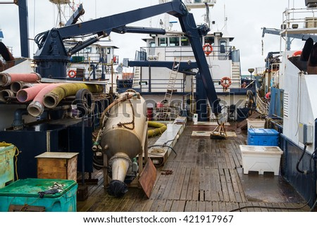 Cluttered deck of commercial fishing boat while undergoing routine maintenance