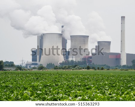 Coal fired power plant with green field in foreground. Weisweiler, Germany