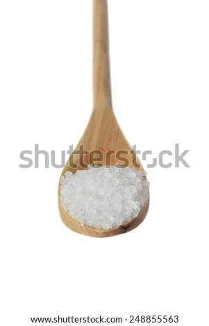 Coarse salt in wooden spoon isolated on white background - for diet or cooking concept