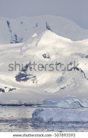 Coast of Antarctica. Glaciers and icebergs of the Southern hemisphere. Global climate change on Earth. Importance of preservation of ecological balance on the planet.