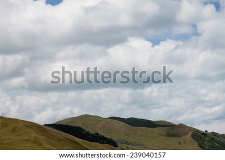 Coastal New Zealand hills with cloud formations