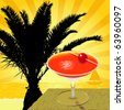 Cocktail on the wooden table at beach sunset - stock photo