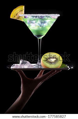 Cocktail Smoothie, with slices of kiwi on a black party background