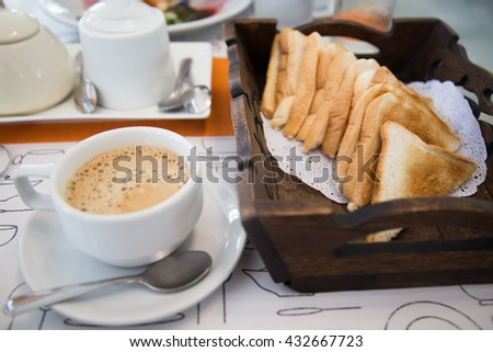 coffee and bread with butter