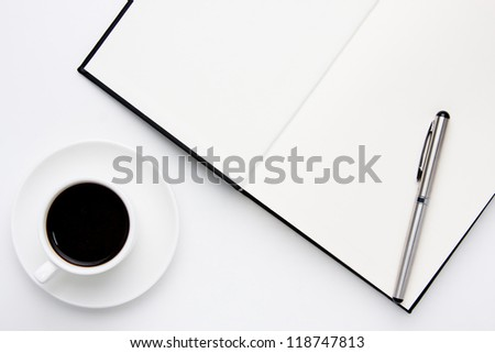 coffee and pen on your book