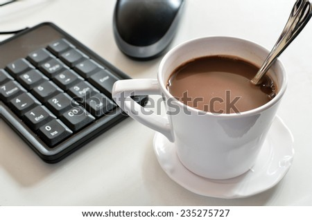 coffee and spoon with technology