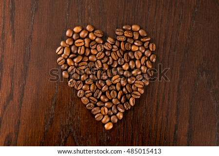 Coffee beans arranged into a heart shape.