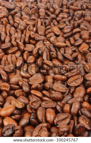 Coffee beans background, big fragrant roasted grains, food photo