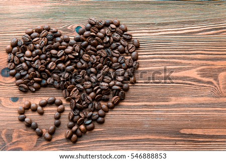 Coffee beans, grain two hearts on background of sacking, bagging. Valentine's Day or Wedding