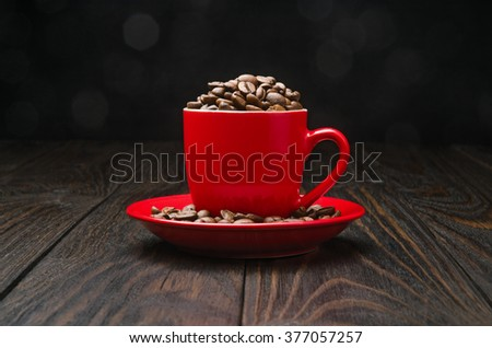 Coffee Beans in a Cup on old wood background