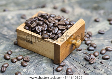 Coffee beans on an old wooden