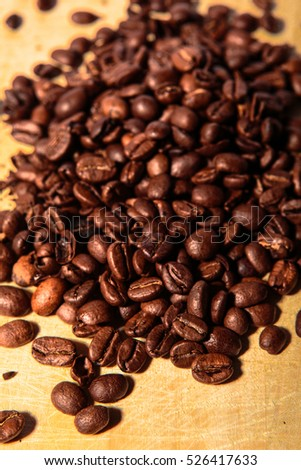 Coffee Beans on Brown Cutting Board.