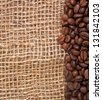 Coffee beans on burlap background - stock photo